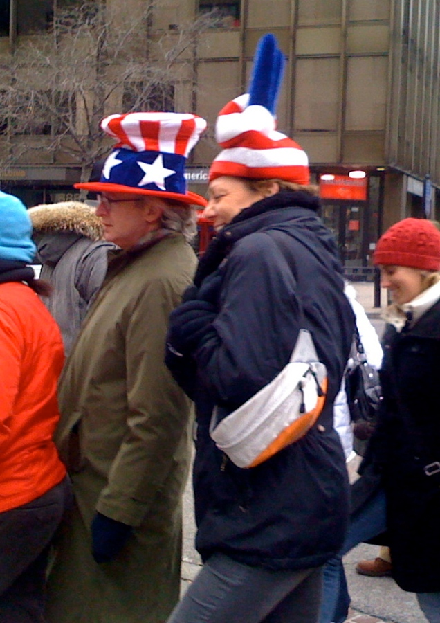 Concertgoers in patriotic (if somewhat silly) hats.