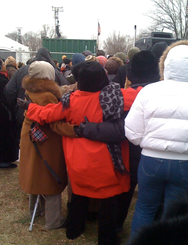 "The ladies in front of me combining a group-hug and singalong to ""America the Beautiful."""