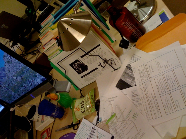 February 13: My messy, messy desk at work. It's about time to tip the whole thing into the recycle bin and start over.