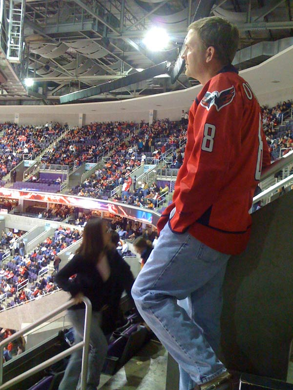 February 24: Brian & I went to see the Caps-Flyers game on Tuesday, and this is him staring off pensively during the first intermission.