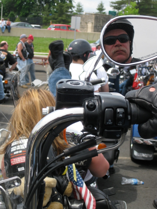 May 24: This is (I think) the coolest photo I took at Rolling Thunder. I like that Steve is in the rearview mirror and that Suzy is laid out on her bike with her feet up.