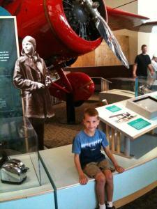 D, posing by Amelia Earhart's plane.