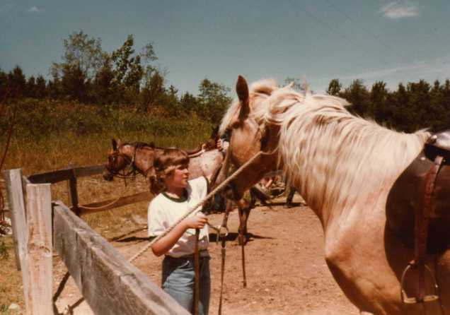 Hanging with the horses at Girl Scout Camp, 1981.