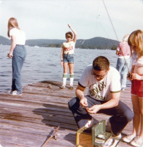 "Dad baits a hook for Eileen while I display my ""catch"" in the background."