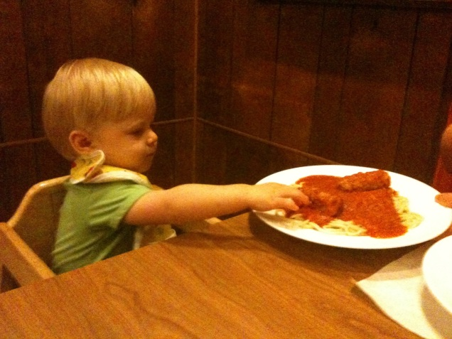 James makes a grab for his first spaghetti and meatballs at Little Venice in Binghamton.