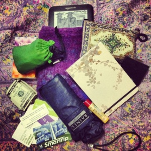 The contents of my purse, dumped out on my bed.