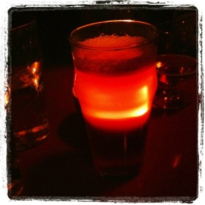 A candle on the table made my birthday beer glow.