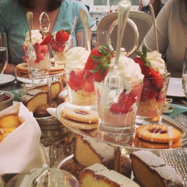 Fancy tea, part two: strawberry shortcake, cookies, cakes, and scones with jam and Devonshire cream.