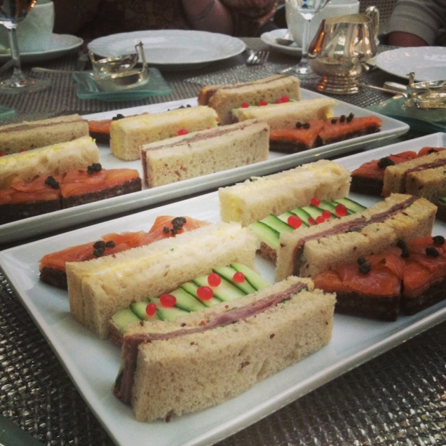 Fancy tea, part one: finger sandwiches (roast beef, cucumber with grapefruit caviar, egg salad, and smoked salmon).
