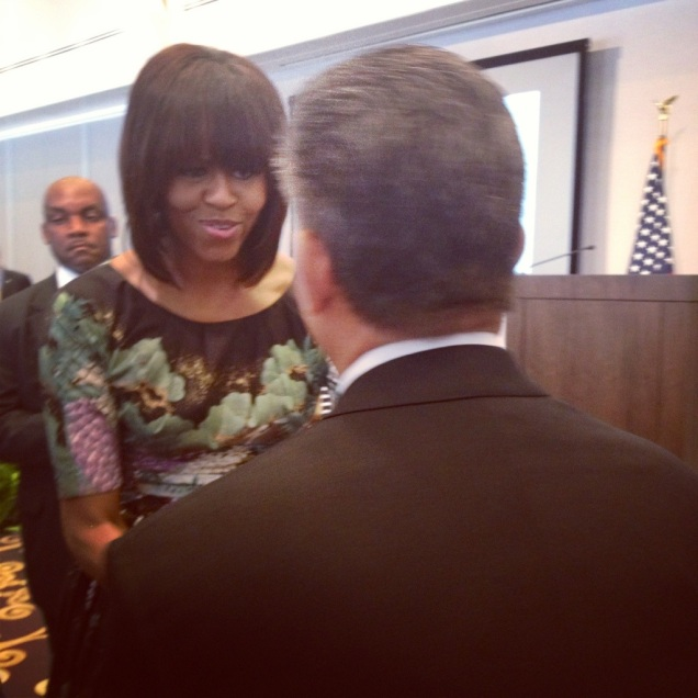 The First Lady shakes hands with the guy sitting in front of me... who just happened to be Ted Leonsis,  owner of my beloved Washington Capitals.