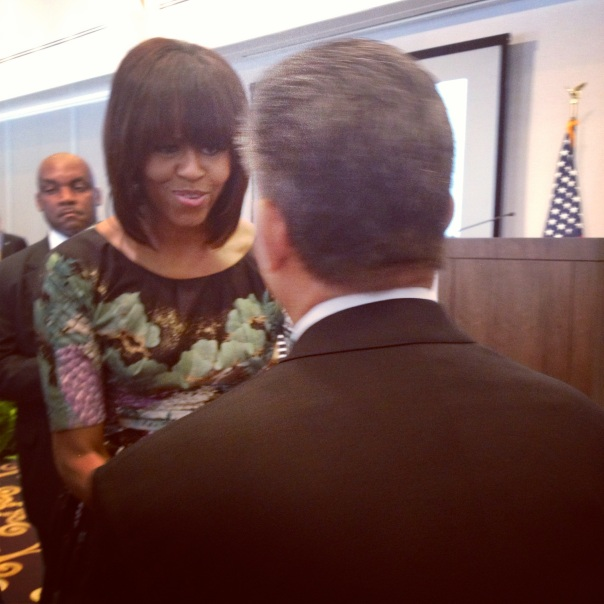 First Lady Michelle Obama -- and the back of Caps owner Ted Leonsis' head.