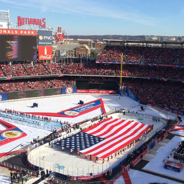 Kids (I think) wearing jerseys from all 30 NHL teams skated out a giant flag for the national anthem.
