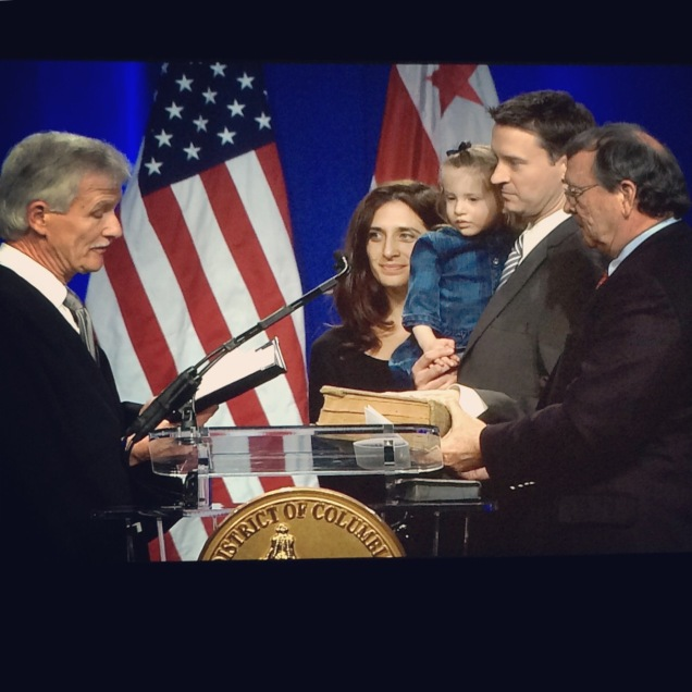 Charles gets sworn in with his wife, daughter, and father at his side.